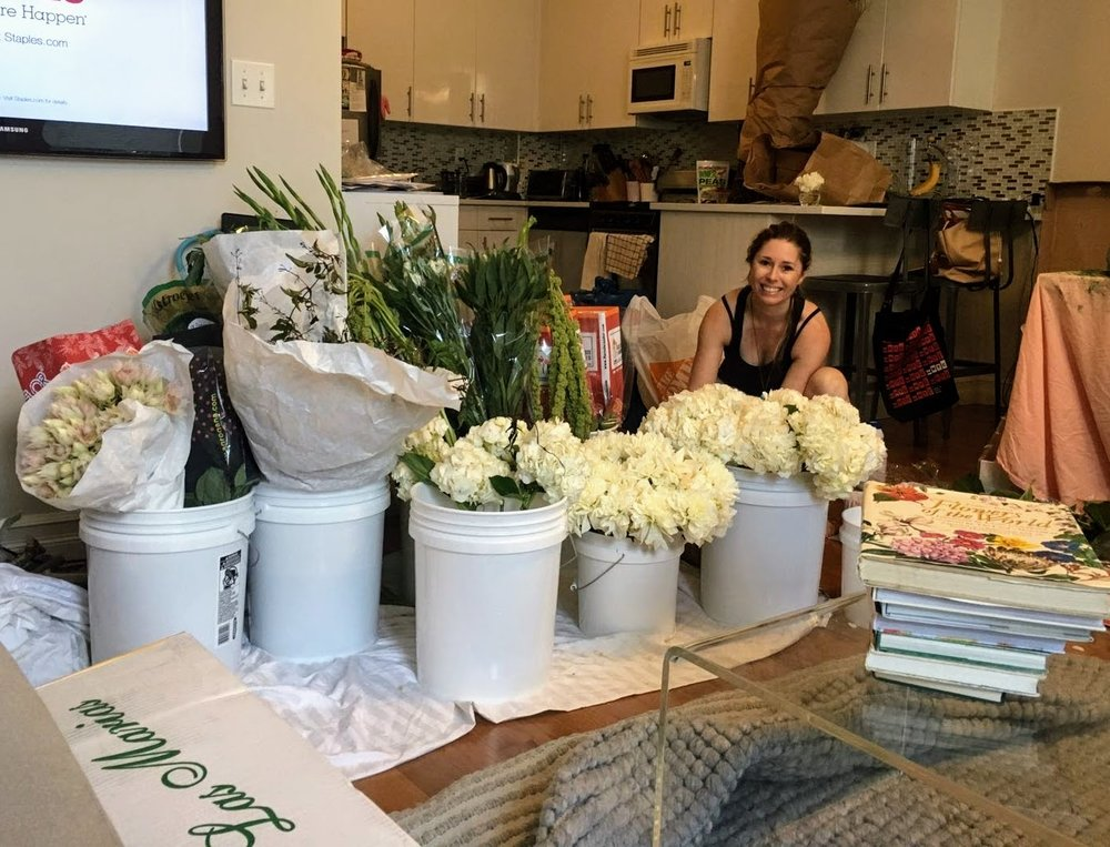Our tiny apartment overrun with wedding flowers