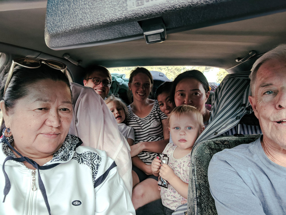 On our way to the World Nomad Games from Bishkek. ( Grandparents, stop reading here .) The five hour drive was completed in record time, with a record number of people stuffed into the five-seater sedan: 6 adults and 2 kids. And Sophie only peed her pants on Danny's lap once.