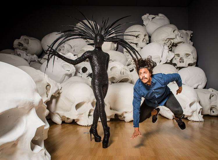 Benjamin Hancock and Thomas E.S. Kelly before Ron Mueck's giant fibreglass  Mass  skulls, as part of Chunky Move's  Accumulation  at NGV Triennial, photographed by Eugene Hyland