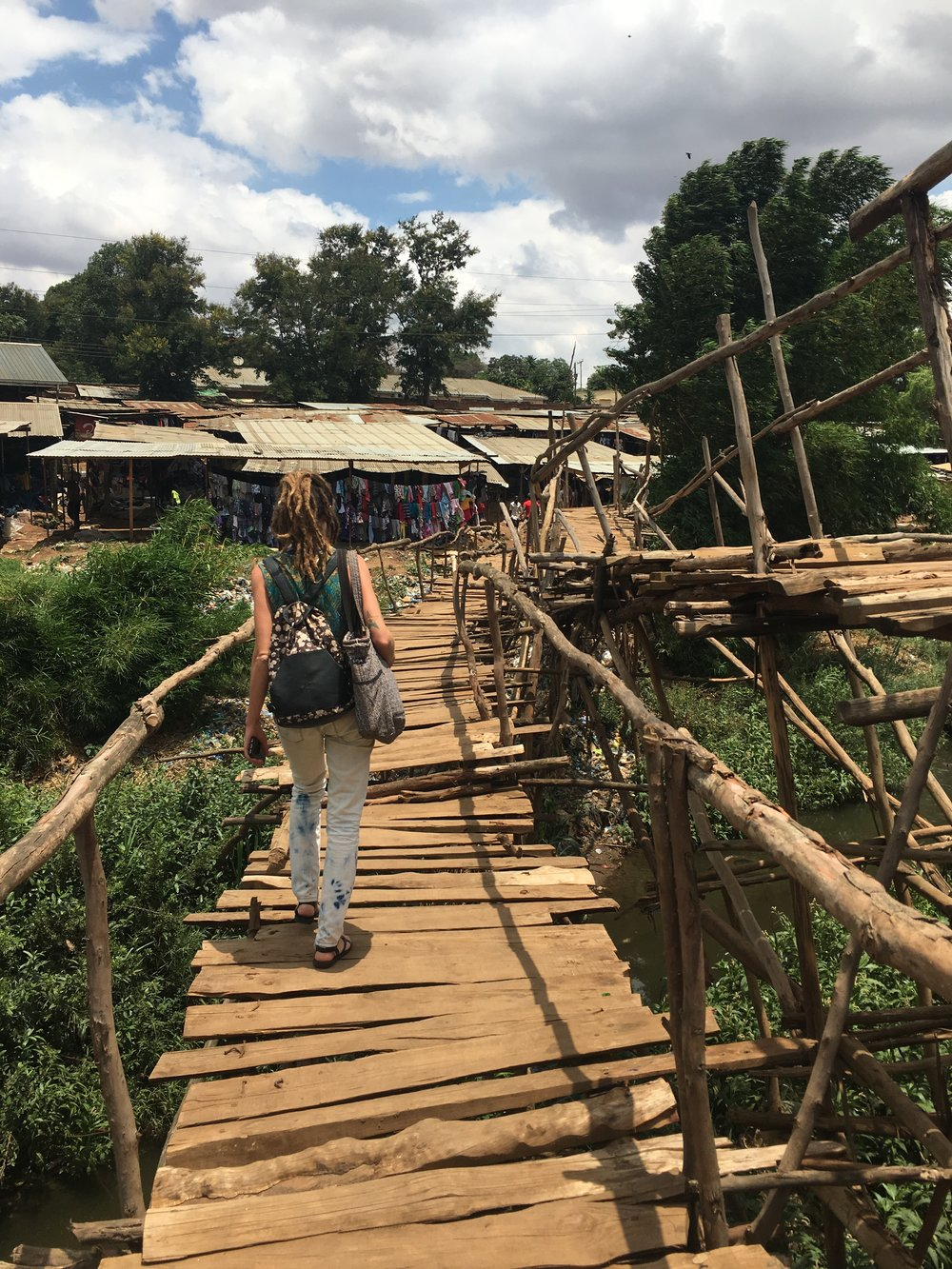 GHF Angela crossing the footbridge in the Lilongwe Market.