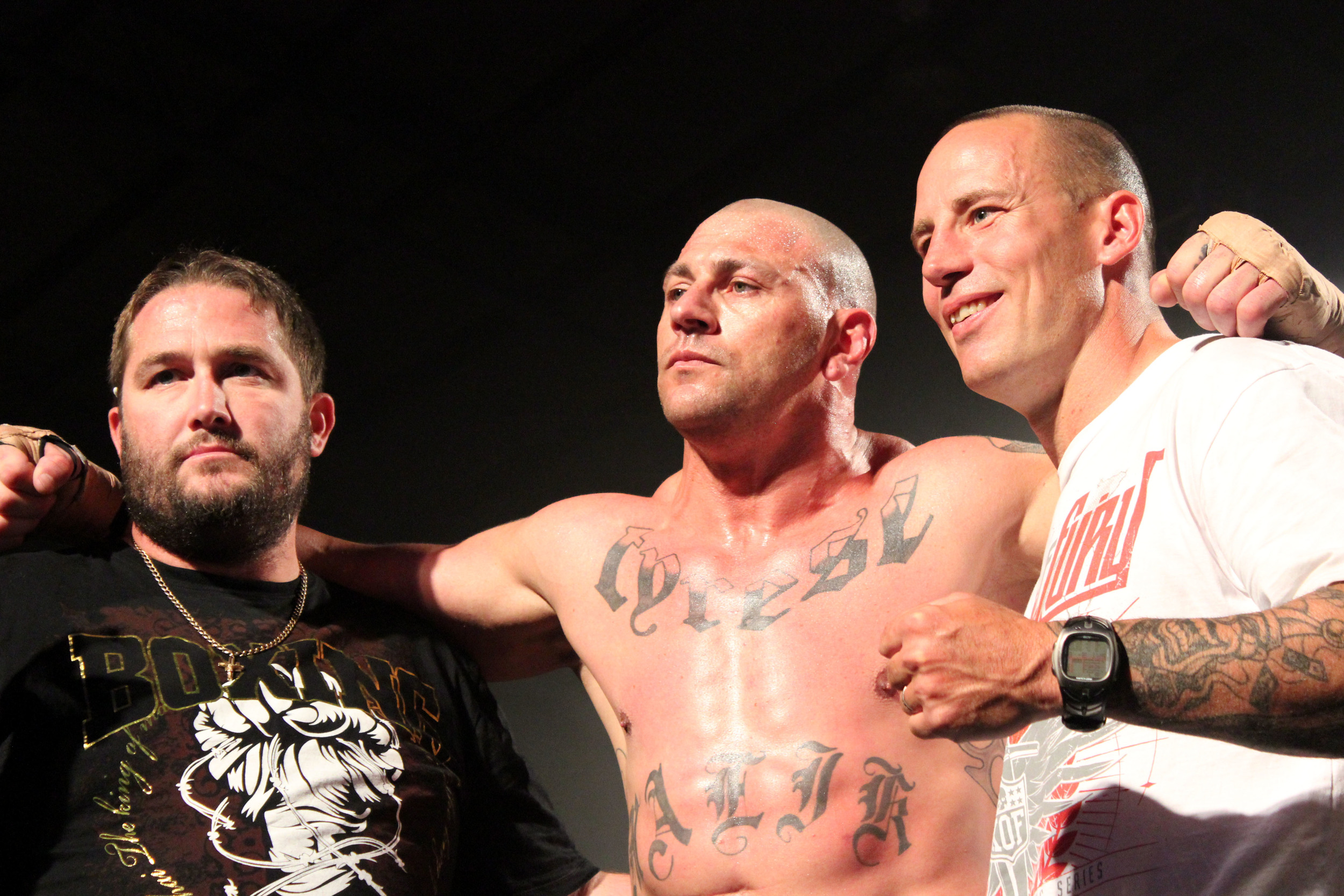 """Andre """"The Giant"""" Meunier (centre) with James Roesler (left) and promoter Ethan Shepp"""