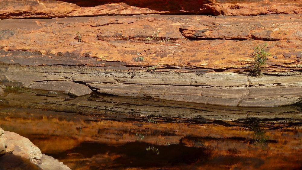 Rock reflections in the waterhole