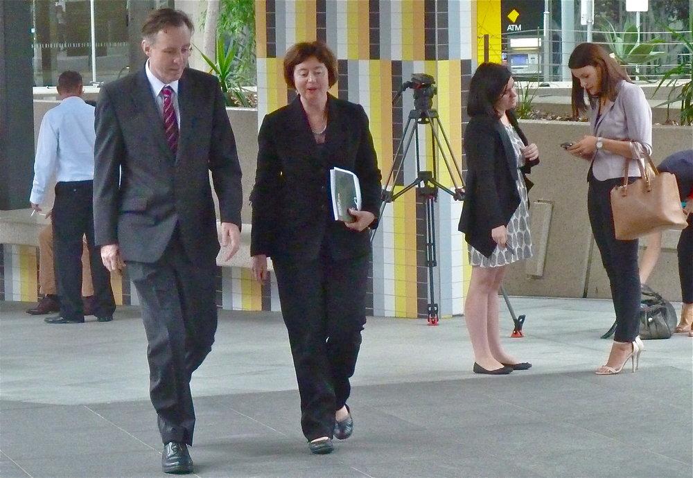 Coast & Country's Derec Davies and EDO CEO Jo-Anne Bragg enter  Brisbane Magistrates Court having met the press (top)
