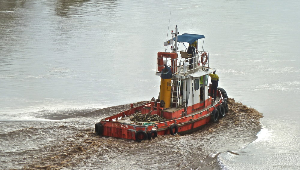 Jan:  tug battling swollen Brisbane River