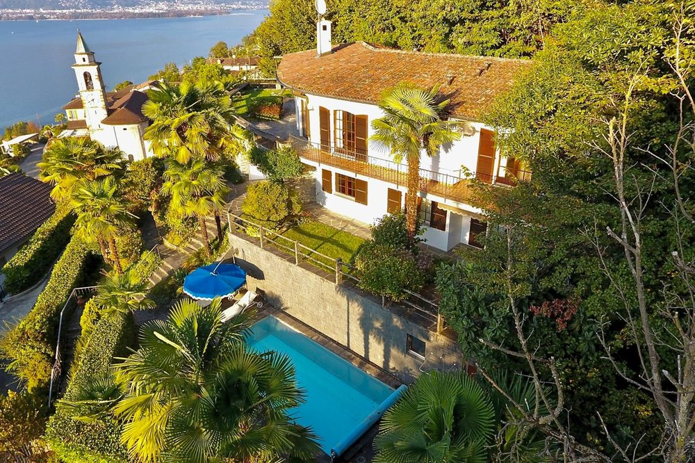 Luxury house for sale at Lake Maggiore, Ticino Switzerland with pool, guest apartment & fantastic lake view