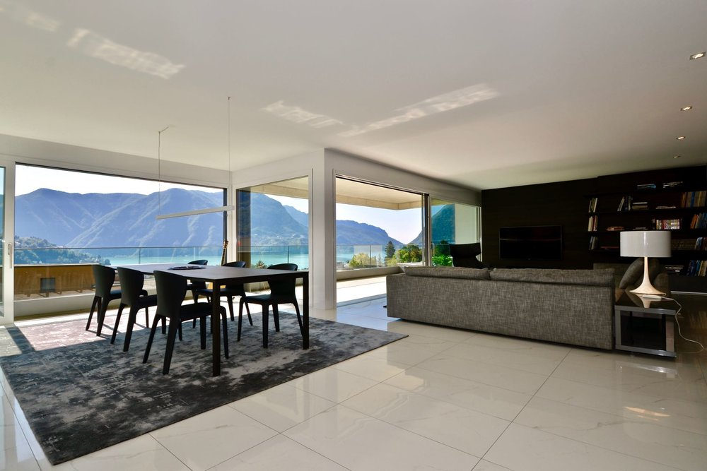 Large living room with open kitchen and fantastic lake view.