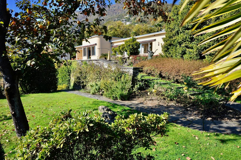 View from the private garden to the Bauhaus style villa in Ascona, Switzerland in a perfect top position for sale