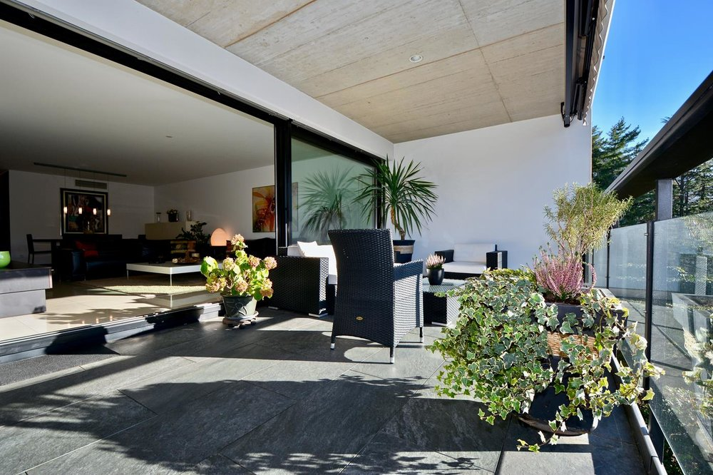 Beautiful terrace, apartment with an open view onto the vineyard in Montagnola, Switzerland for sale