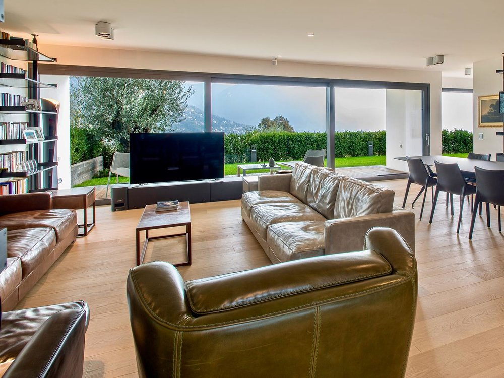 Large living room with a splendid view - Luxury apartment in Belvedere district of Porza, Switzerland near Lugano for sale