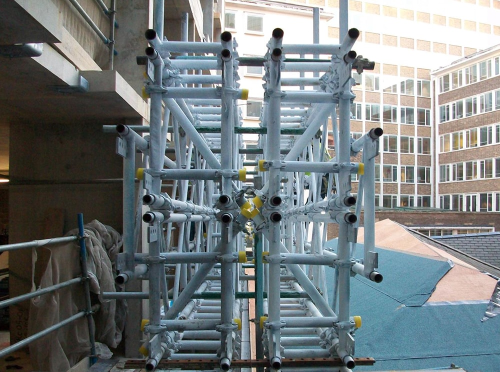 Two layers of scaffolding beams positioned together to increase depth