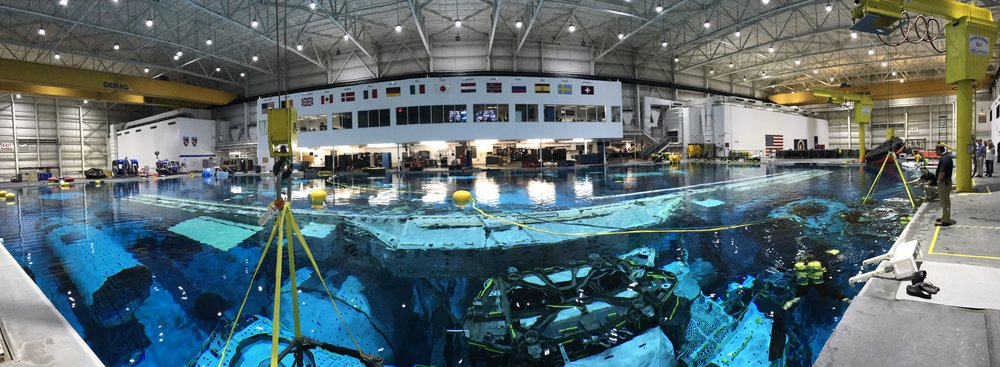 IPhone panorama of the pool area. In the top center of the image, you can see the control room for the facility and training.