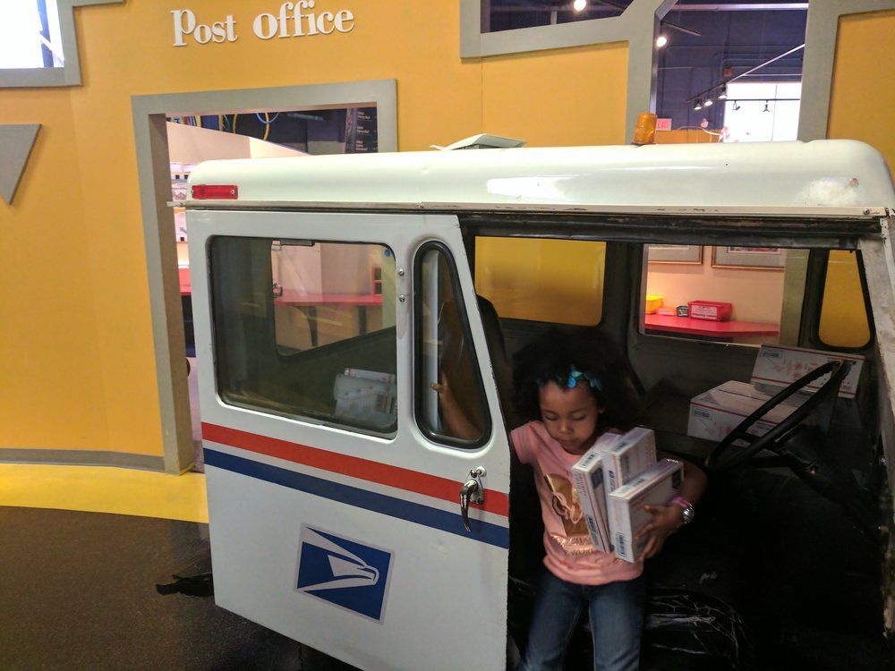 My babygirl delivering emerging and advanced technology enhanced mail at the Greensboro Children's Museum