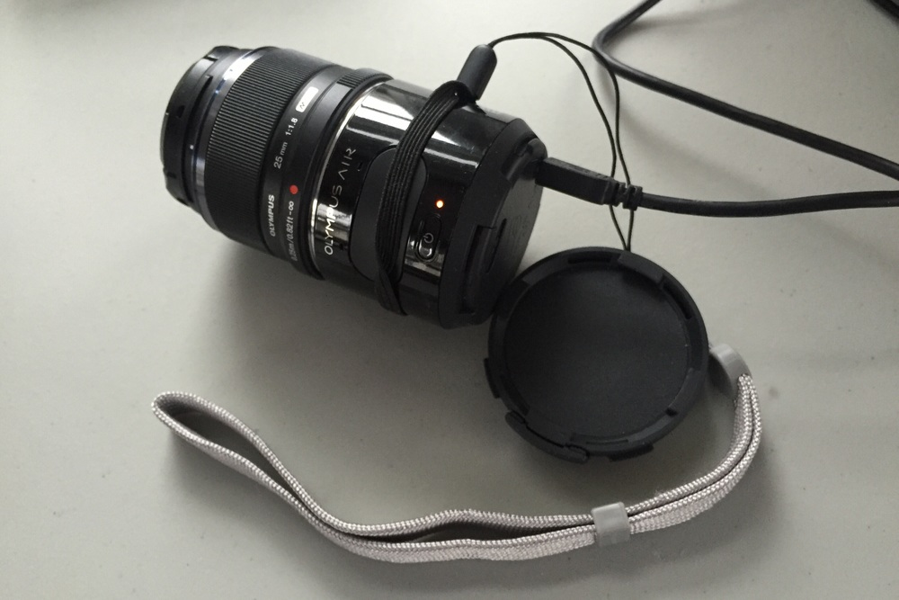 The Olympus Air with lens attached.