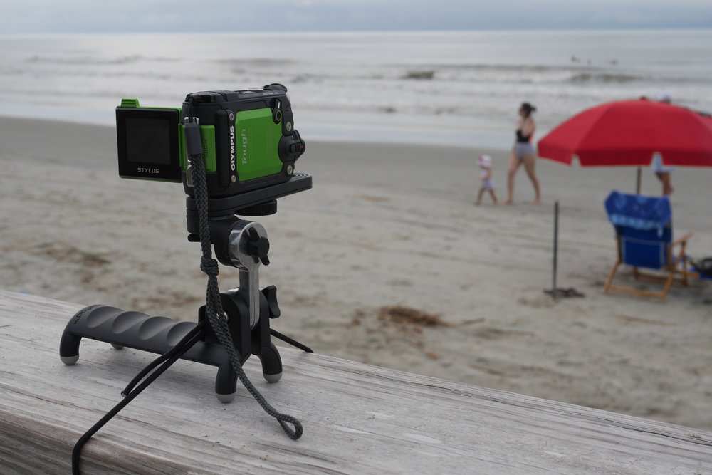 The HandlePod in action holding my Olympus Tough TG-Tracker on a beach boardwalk railing.