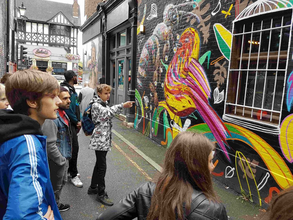 TG delivers commentary to crowd in colourful Camden alley.jpg