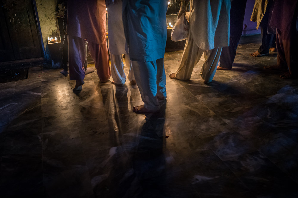 Sufi men preparing for prayer at Baba Shah Kamal Shrine in Lahore, Pakistan.