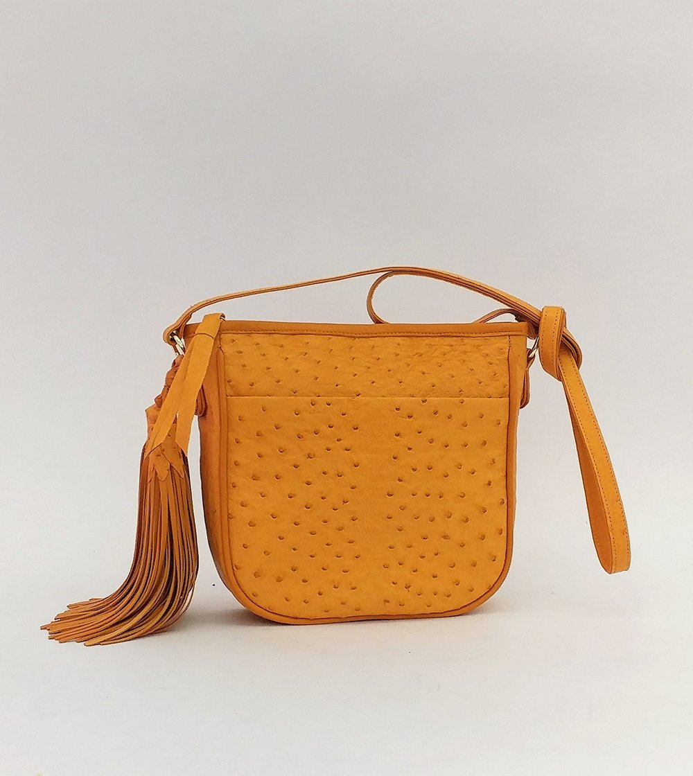 Lois A. brought us her old, but threadbare bag, remade here in a new material.