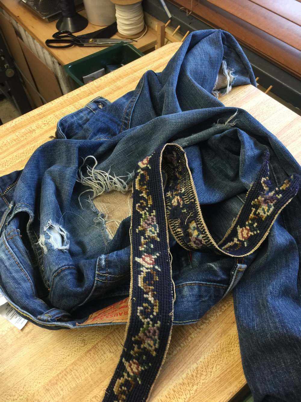 Patch is placed along the seam of the jeans and stitched into place