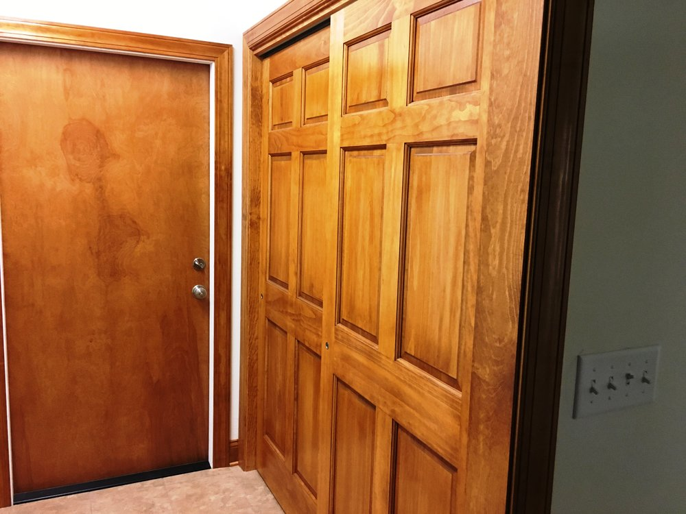 Washroom with Door to Garage Sliding Doors to Closet