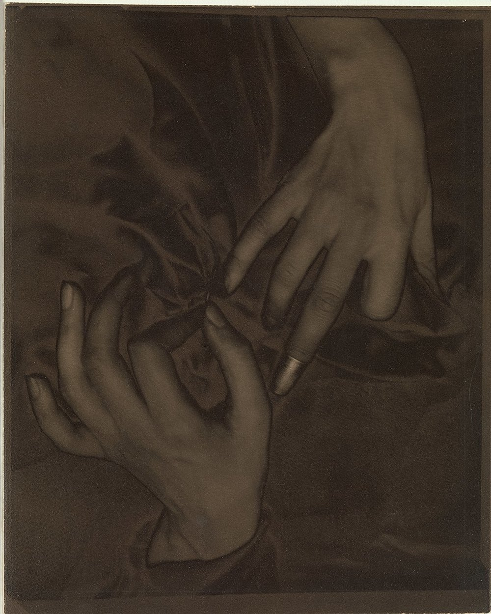 1024px-Georgia_O'Keeffe_–_Hands_and_Thimble_MET_DP235214-CC0.jpg