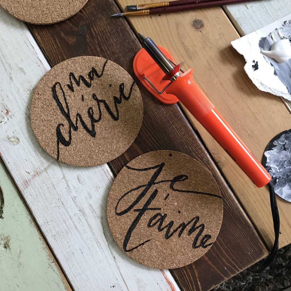 "From chalkboards to wood signs to even burning cork, ""fauxlligraphy"" will get you that look without using the finicky calligraphy nib!"