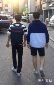 Kim (19, right) who is all-alone, walks with Lee (17) who will age out next year.