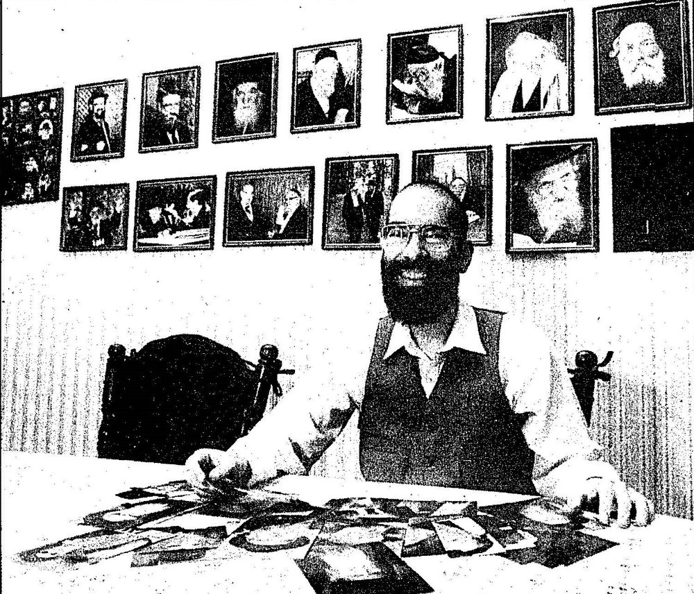Arthur Shugarman, the founder of Torah Personality Cards, displaying some of his collection. Before launching his