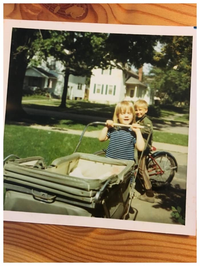 Finally, here is a picture of my big sister (and a neighbor boy) pushing me around in a stroller sometime around 1971. I used this picture or the idea of it in Gem & Dixie.
