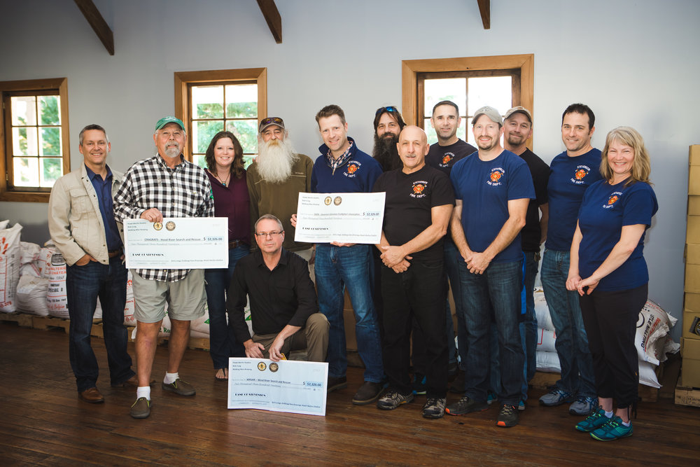 Recipients from Crag Rats Search and Rescue, Wind River Search and Rescue and the Stevenson Volunteer Firefighters Association each receive $2326.00 from the benefit concert held at Walking Man Brewing in conjunction with Hawk Merlin Studios on September 16, 2017.