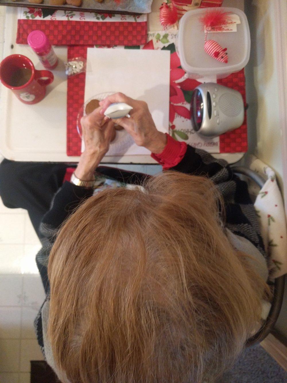 Nannie decorating her gingerbread man
