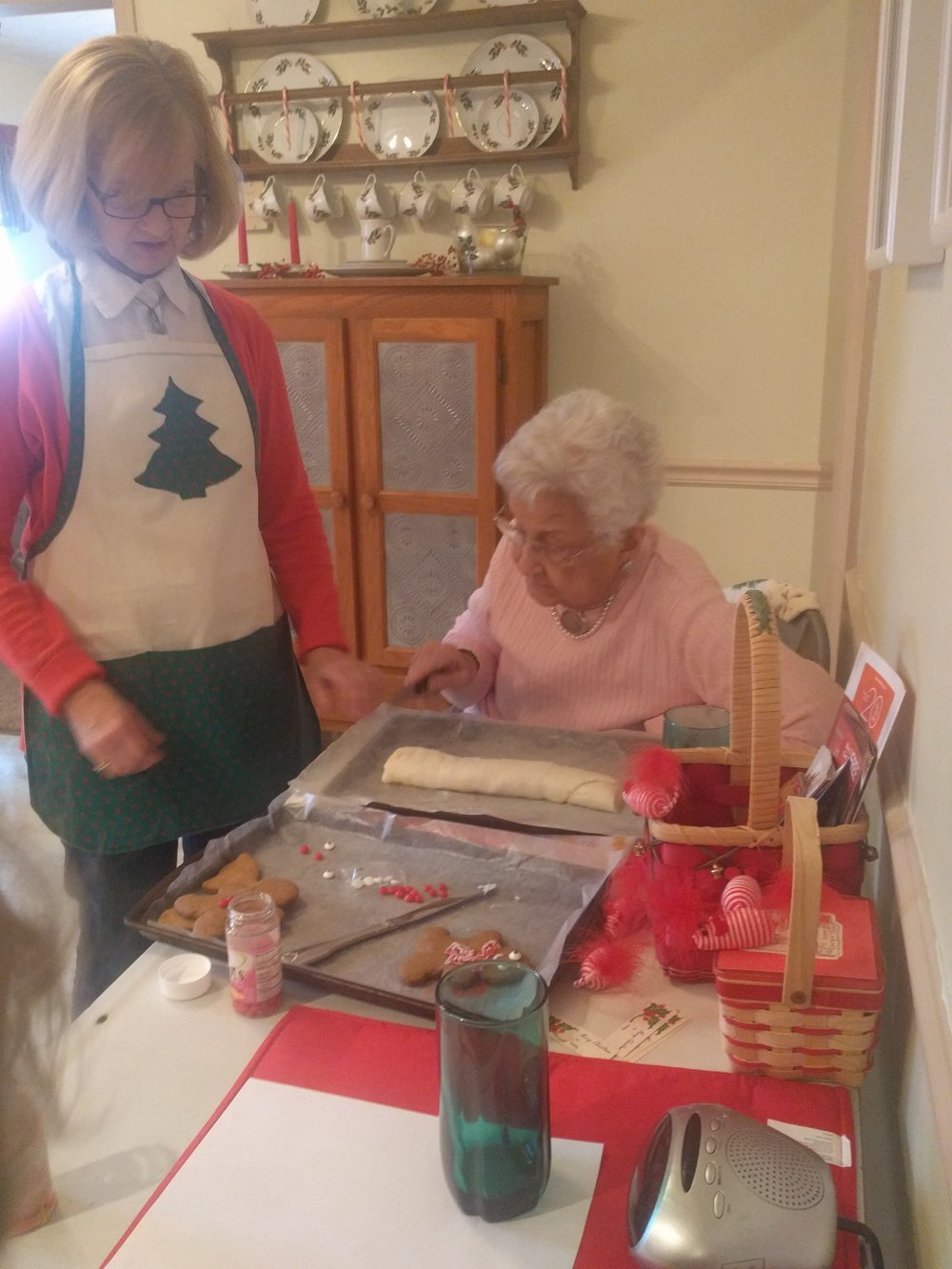 Grandmom slicing up the potato candy with mom's help.