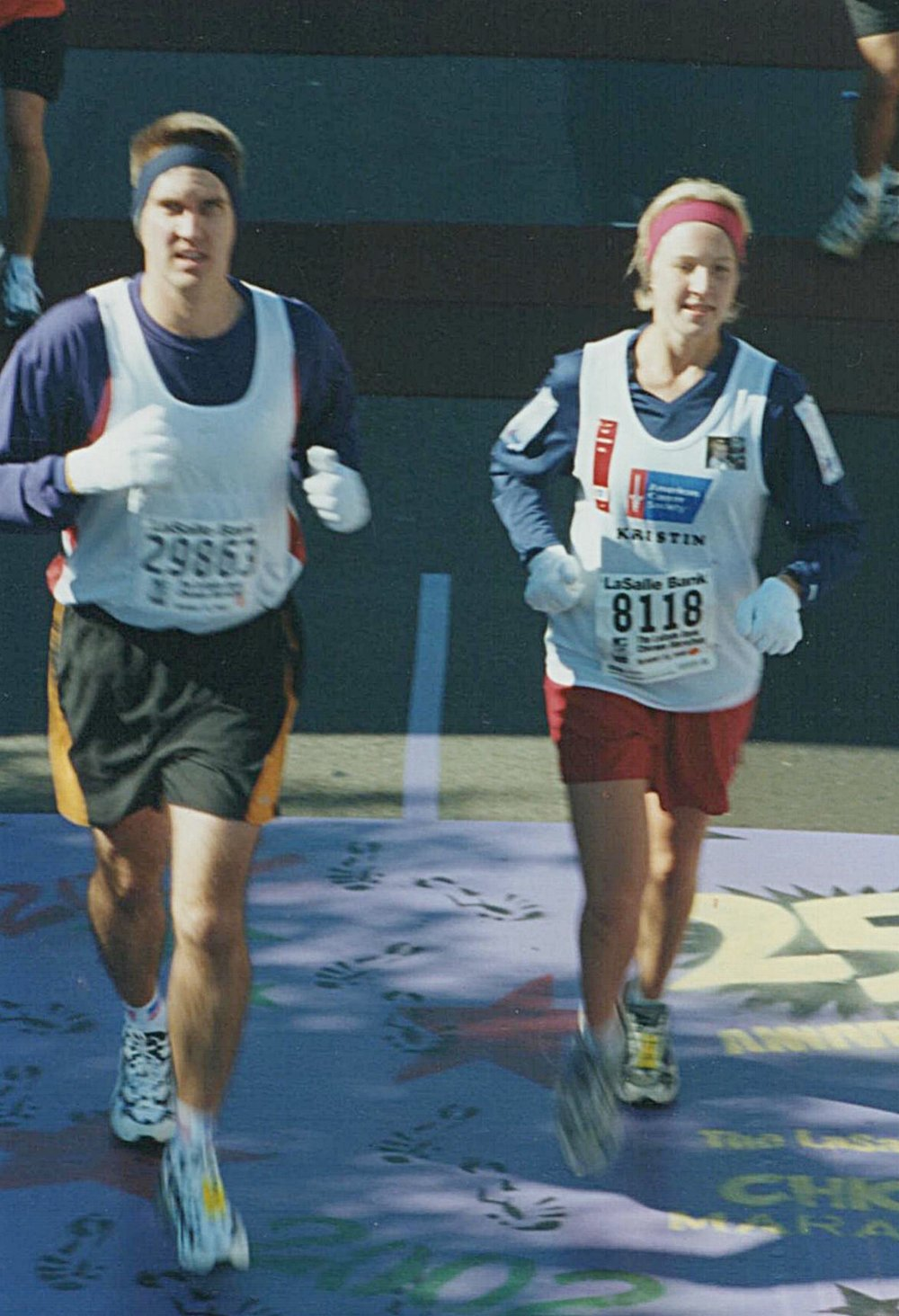 Kristin takes on the 2002 Chicago Marathon, her first, with uncle   Jim Legner.