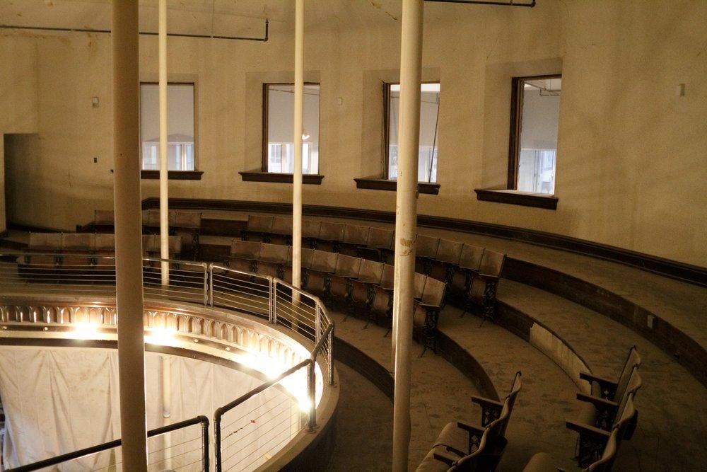 the choir loft still overlooks the sanctuary turned workshop