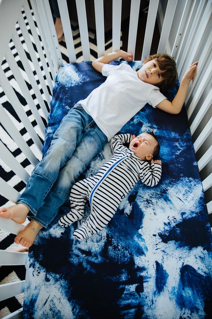Brothers-laying-in-crib-photo-1.jpg