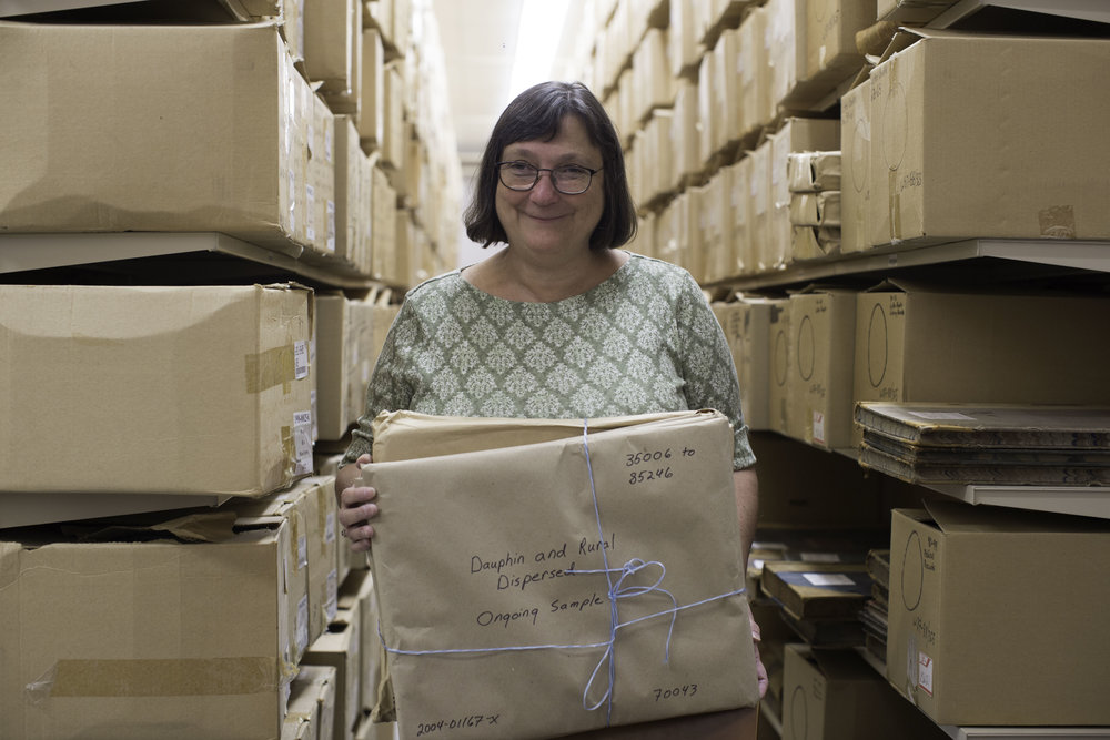 Evelyn Forget among the thousands of records from the Mincome experiment  (copyright Truth Be Told)