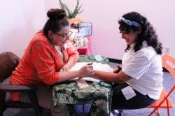 Barbara applying henna to Shereen