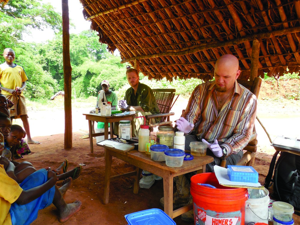 Associate Professor of Biological Sciences Eli Greenbaum (center) is seen with a Npenda village chief (on Greenbaum's right), villagers and expedition team members near Lake Tumba, Equator Province, Democratic Republic of Congo. Photo courtesy of Eli Greenbaum