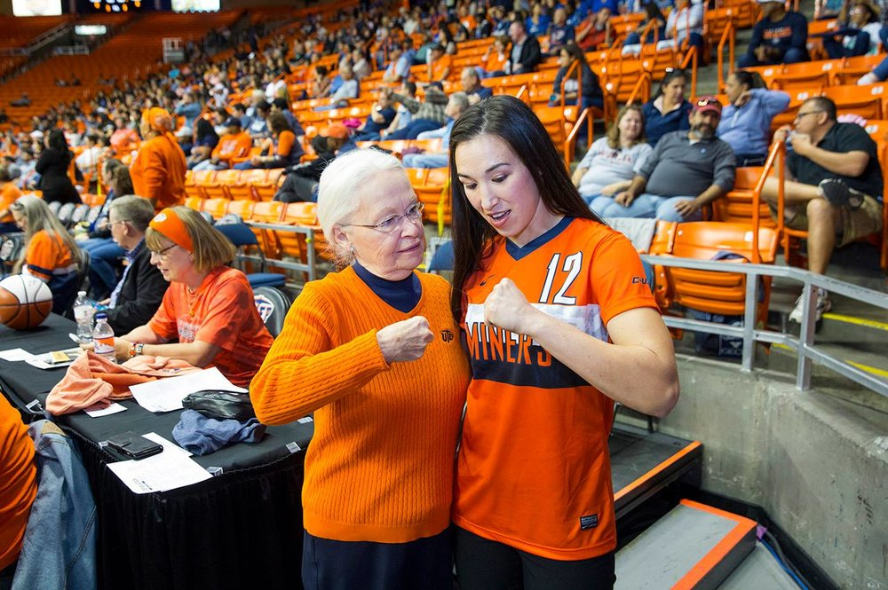 During a break at a UTEP basketball game in February 2018, Han chatted with President Diana Natalicio and showed her the proper way to form a fist to throw a punch. Photo by Ivan Pierre Aguirre
