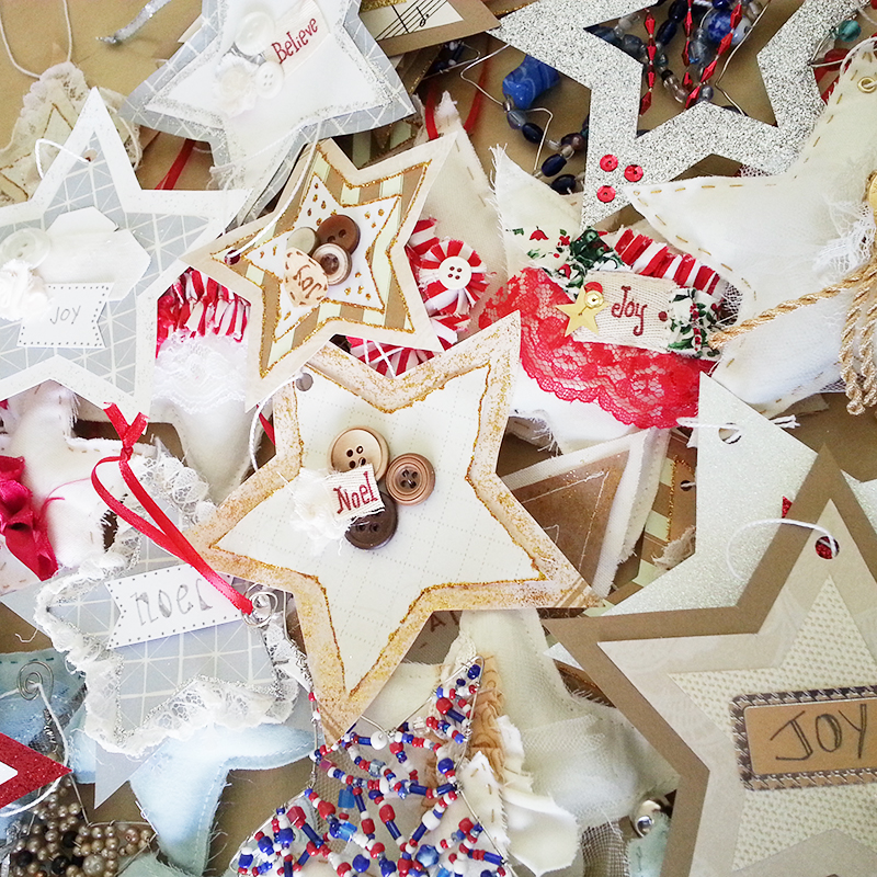 Pretty star ornaments made from paper. fabric and beads given to a local nursing home.