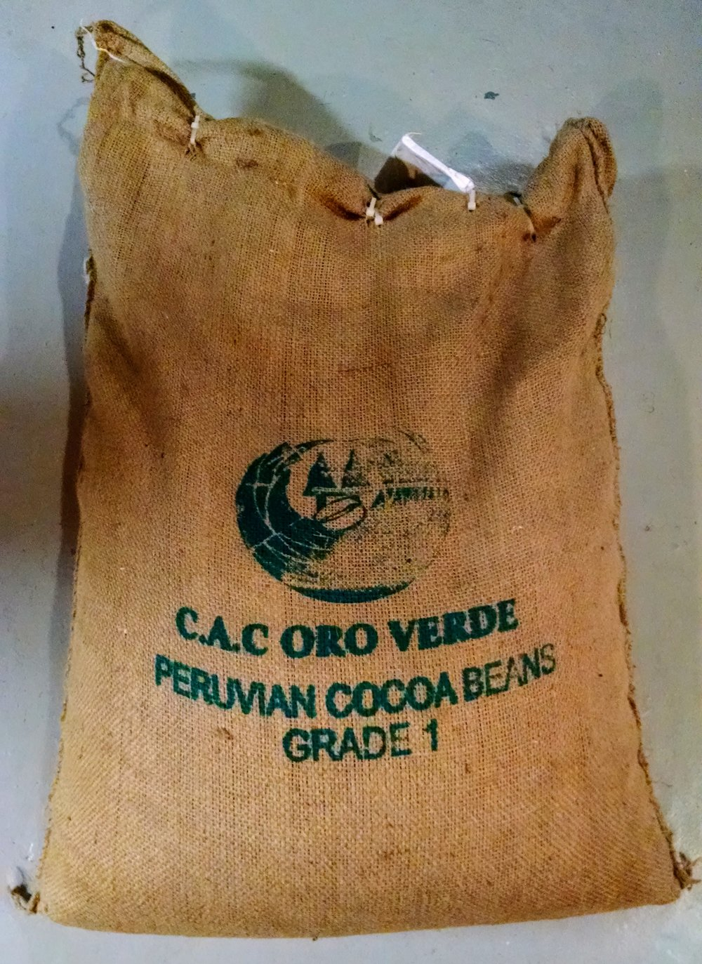 A bag of cocoa from the Oro Verde co-op in Peru, which uses its price premiums to offer technical assistance, medical care, and increased food security to its farmers.