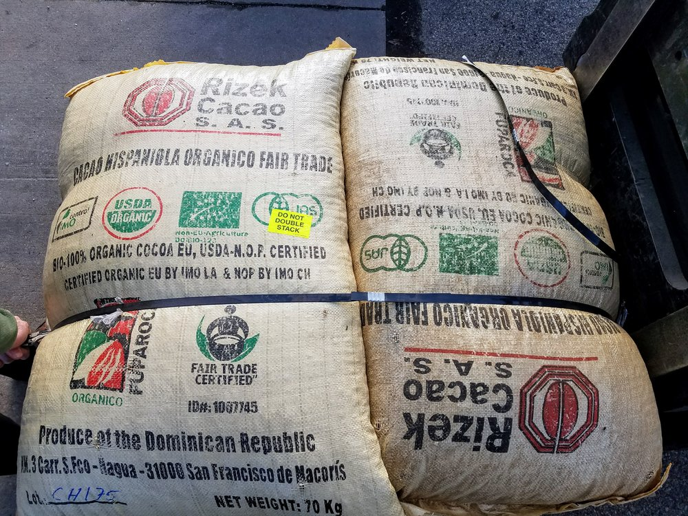 Receiving two bags of Dominican cacao purchased through Chocolate Alchemy, an important specialty cacao supplier.