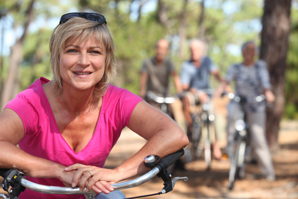 stock-photo-two-middle-aged-couple-on-bike-ride-119580001.jpg