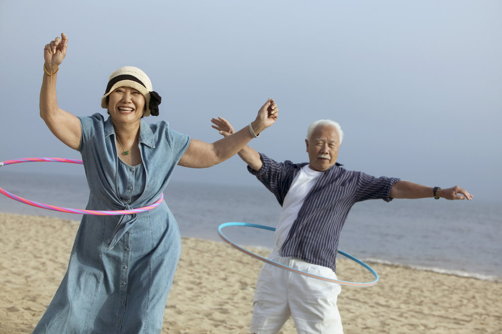stock-photo-middle-aged-couple-hula-hooping-99203876.jpg