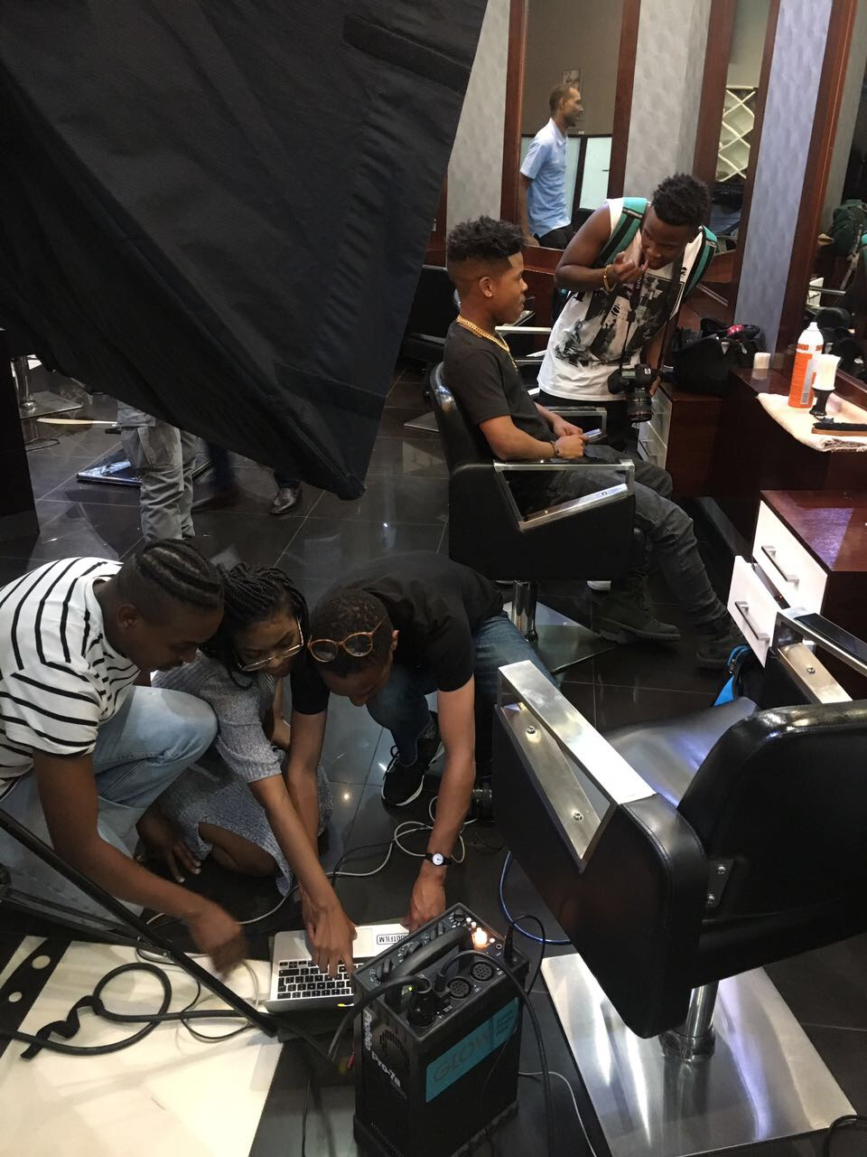 Preparing for a shoot with Nasty C with photographer  Andile   Buka