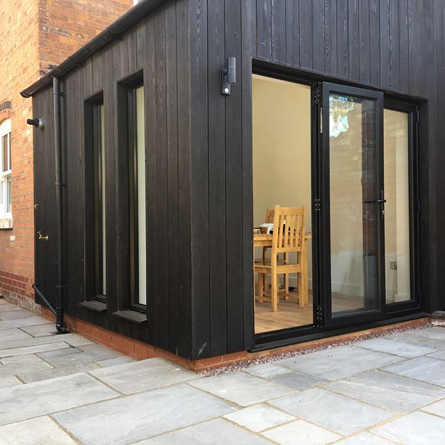 Turning a dull 1980 s extension in to the 21st century  with black windows and doors  Japanese burnt larch @interventionarchitecture #wowdevelopments #birminghambuilders #build #architecture #design#japaneselarch #wood #house #livingspace #kitchen