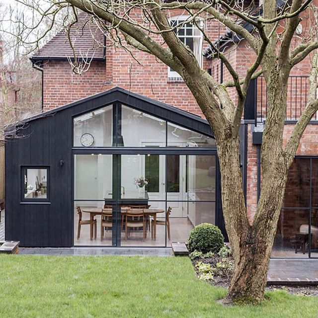 A recently finished project in #Moseley to a charred timber extension to a #Victorian house - architect @interventionarchitecture photo @handoveruk #design #bespoke #extension #renovation #modernhouse #moseley architecture #polishedconcrete #builders #build #goodwork
