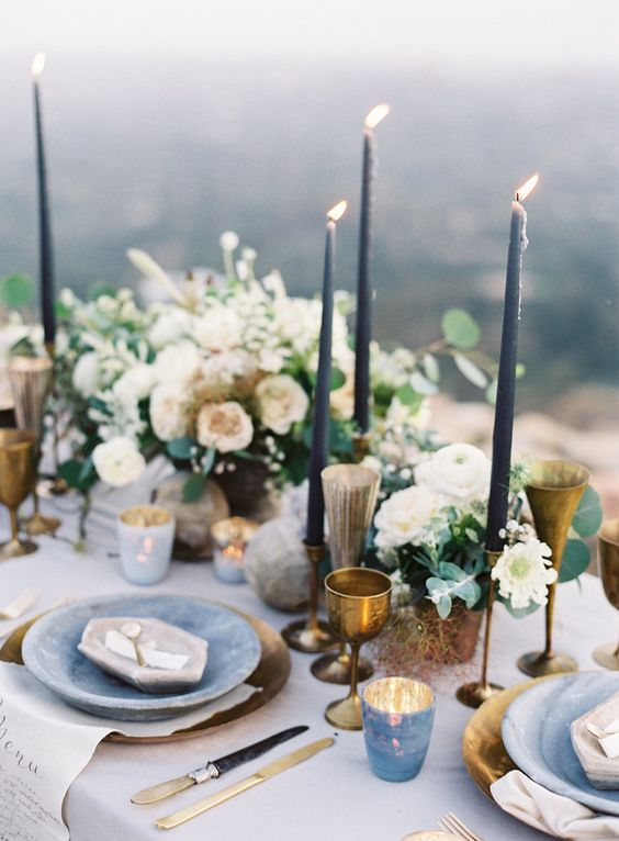 04-a-moody-spring-table-setting-with-slate-blue-candles-brass-glasses-and-goblets-stone-inspired-plates-and-marbeleized-candle-holders.jpg