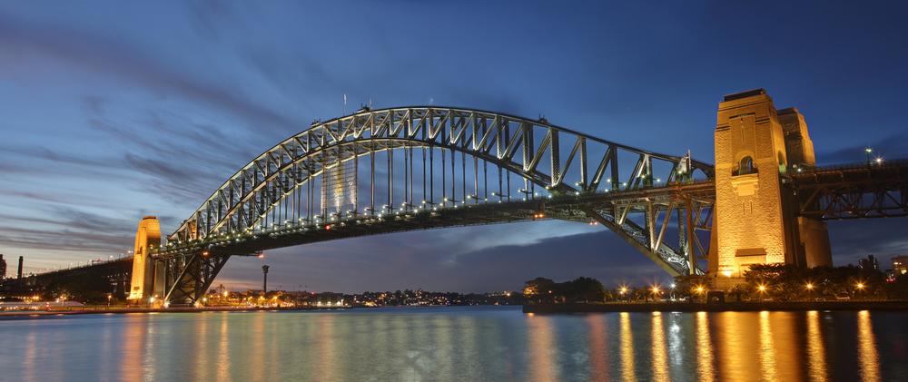 """""""Sydney Harbor Bridge Dusk""""  by  Adam J.W.C.  licensed under  CC Y-SA 2.5 ."""
