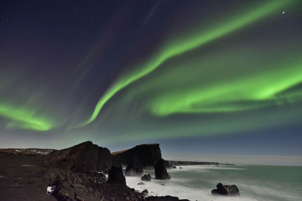 Northern Lights over Reykjanes Peninsula Sea Stacks, Iceland by  Diana Robinson  licensed under  CC BY 2.0