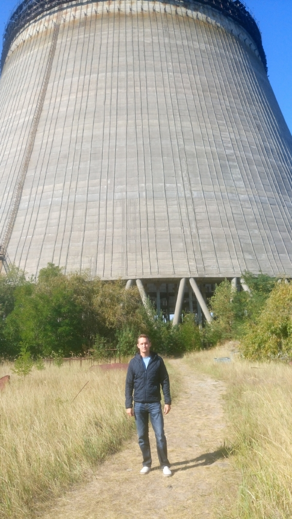 Standing in front of partially-constructed Cooling Tower #5 abandoned overnight after the Chernobyl nuclear disaster in 1986
